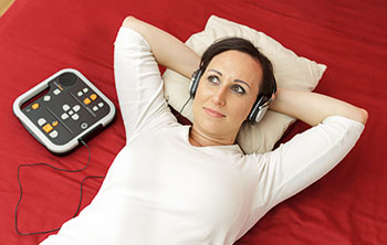 Photo of woman listening to audiobook